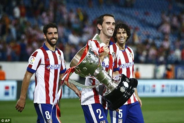 1409436267029_wps_12_Atletico_s_Diego_Godin_fr